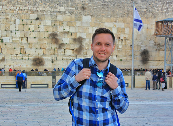 Young man in front of the Kotel